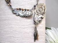 Beaded Necklace: Asymmetrical Carved Shell Tassel