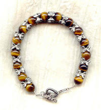 Large Round Tigereye Beads and Pewter Vertebrae Spacers Bracelet
