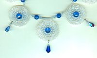 Graduated Needlewoven Roundels and Faceted Sapphire Glass Collar
