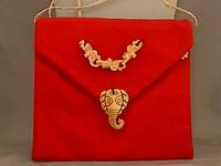 Deep Crimson Shoulder Bag with Carved Bone Elephants